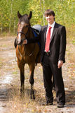 Bridegroom and horse Stock Image
