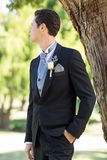 Bridegroom looking away in garden Stock Image