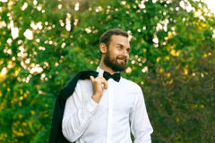 Bridegroom in a park. In spring royalty free stock photo