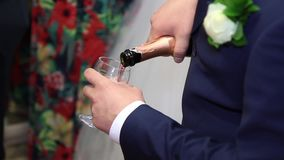 Bridegroom pours champagne. Groom pours champagne. Bridegroom HD stock footage