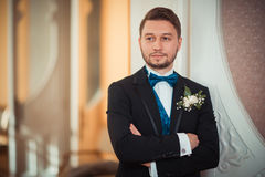 Bridegroom preparing for the wedding. Straightens his shirt sleeves royalty free stock photo