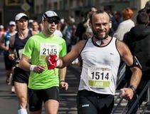 Bridegroom running at Maraton Stock Photo