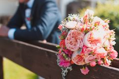Wedding bouquet. Bridegroom waiting his bride with the wedding bouquet Royalty Free Stock Photography