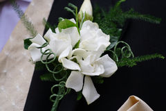 Bridegrooms Buttonhole. Flowers in the buttonhole of the bridegroom at a wedding stock image