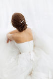 Brides beauty. Young woman in wedding dress indoors Royalty Free Stock Photos