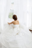 Brides beauty. Young woman in wedding dress indoors Stock Photo