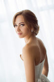 Brides beauty. Young woman in wedding dress indoors Stock Image