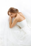 Brides beauty. Young woman in wedding dress indoors Royalty Free Stock Image