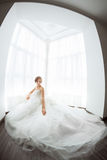 Brides beauty. Young woman in wedding dress indoors Royalty Free Stock Images