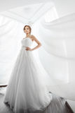 Brides beauty. Young woman in wedding dress indoors Stock Photography