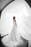 Brides beauty. Young woman in wedding dress indoors Stock Photos