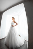 Brides beauty. Young woman in wedding dress indoors Stock Images