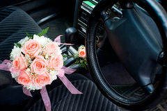 Brides bouquet. Inside a car between front seats Stock Image