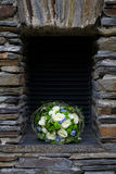 Brides bouquet. Beautiful wedding bouquet in a stone niche Royalty Free Stock Image