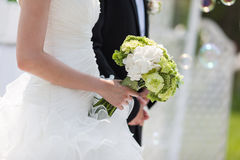Brides Bouquet. A bride holds her bouquet at wedding Stock Images