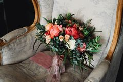 Brides bouquet on the armchair. In expectation of the bride Royalty Free Stock Photos