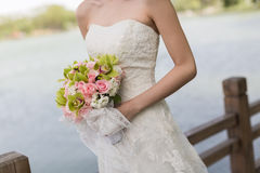 Brides Bouquet. A bride holds her bouquet at an outdoor wedding Stock Photo