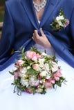 Brides bouquet on bride knees Stock Images