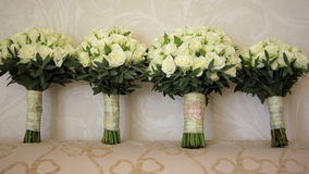 The brides bouquet and the bridesmaids stock footage