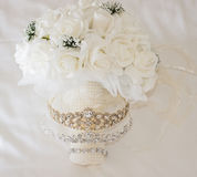 Brides bouquet bunch of flowers and jewellery Royalty Free Stock Images