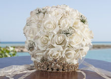 Brides bouquet bunch of flowers and tiara on table Stock Photo