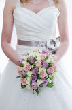 Brides bouquet and dress detail Stock Photography