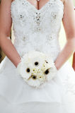 Brides bouquet and dress details Stock Image