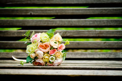The brides bouquet. Gentle spring bridal bouquet on the bench royalty free stock photos