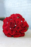 Brides Bouquet of red roses. On stone Stock Photography