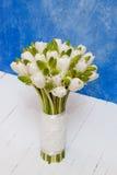 Brides bouquet. White tulips on the white floor Stock Photo