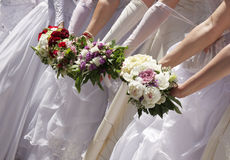 Brides with bouquets Stock Images