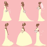 Brides in different style dresses Royalty Free Stock Photos