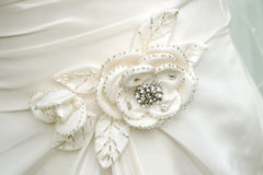 Brides dress flower detail. Royalty Free Stock Photo