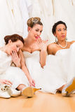 Brides drinking too much champagne Royalty Free Stock Photos