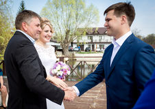 Brides father shaking hands with groom at wedding ceremony Royalty Free Stock Photography