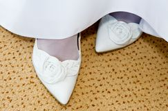 Brides Feet. Bride's feet and white shoes at wedding stock photos