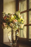 Brides flowers. Flowers for the bride. Great window light in a cozy cottage Stock Images