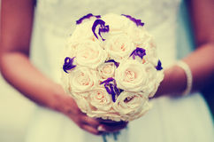 Bride Bouquet. Bride posing with flowers in her hands royalty free stock photos