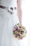 Brides flowers and dress closeup Royalty Free Stock Photos