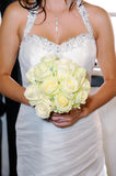 Brides flowers and dress detail Royalty Free Stock Image