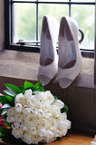 Brides flowers and shoes Royalty Free Stock Image