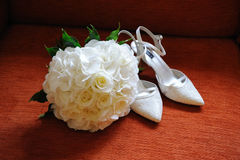 Brides flowers and shoes. Brides white roses and white shoes Stock Photo