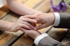Brides and grooms hands Royalty Free Stock Image