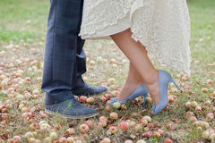 The brides and grooms legs, close up, in autumn Royalty Free Stock Photo