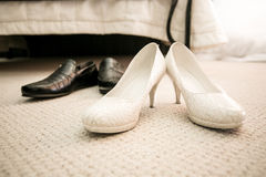 Brides and grooms shoes on floor at bedroom Royalty Free Stock Image