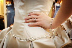 Brides hand and diamond ring on hip waiting to wal Stock Photo