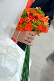 Brides hand holding bouquet Royalty Free Stock Images