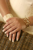 Brides hands. On a chair back Stock Image