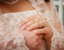 Brides Hands. Bride to be with clasped hands and diamond ring Stock Images