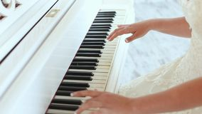 Brides hands playing the piano indoors stock video